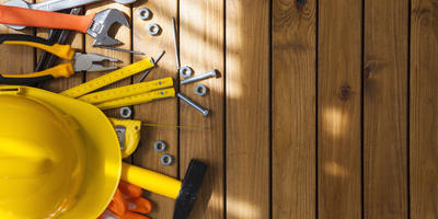 Set of assorted working tools on wooden background