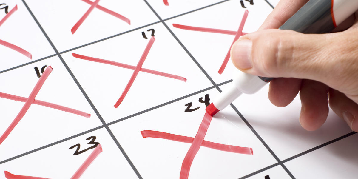 Calendar with marker crossing days out
